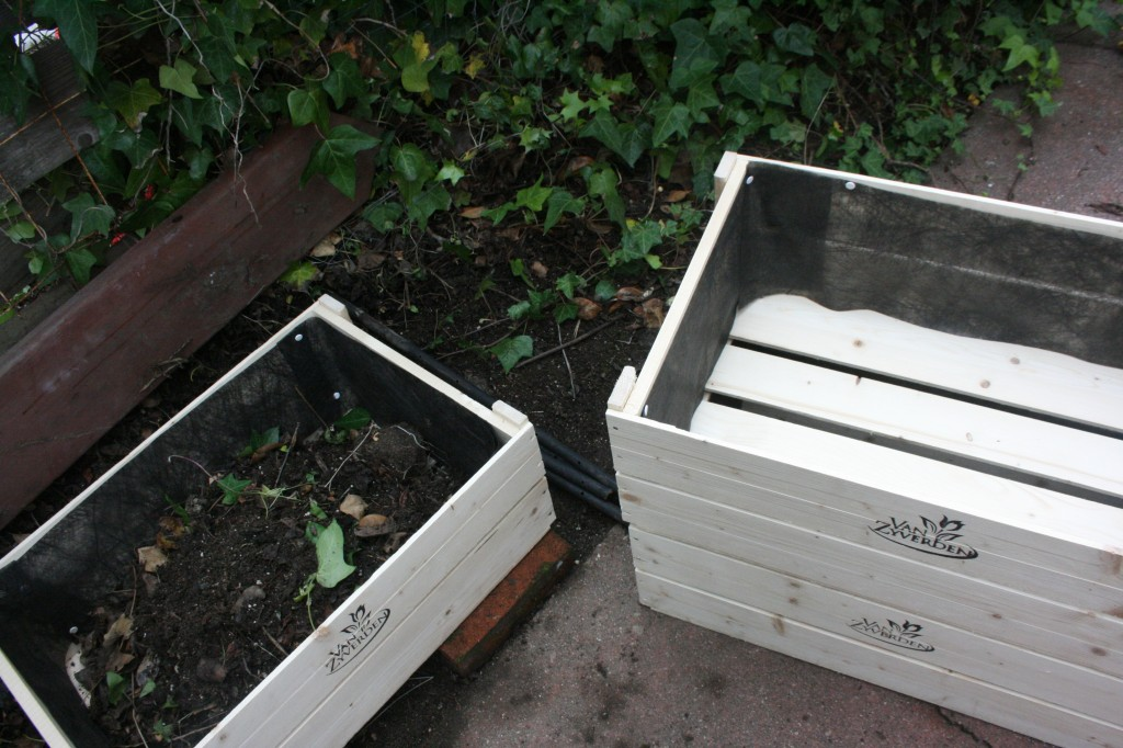 make a compost pile out of three wooden crates